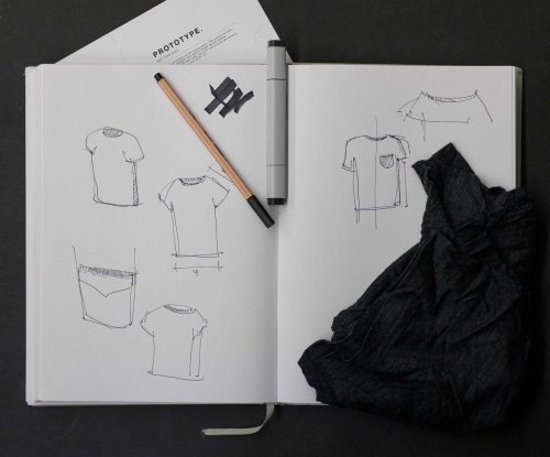 T-shirt sketches in notebook
